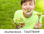 woman eating healthy salad from ... | Shutterstock . vector #726578449