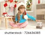 little girl making christmas... | Shutterstock . vector #726636385