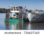Small photo of Pusher boat stands moored near cargo ship on Danube river, Ruse, Bulgaria