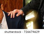 Small photo of Businessmen encourage : Businessman smashing shoulders encouraging colleagues : Close up of male business man comforting colleagues with worries.