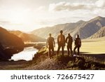 group of four people stands on... | Shutterstock . vector #726675427