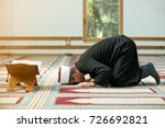 young imam praying inside of... | Shutterstock . vector #726692821