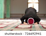 young imam praying inside of...   Shutterstock . vector #726692941