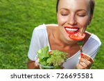 woman eating healthy salad from ... | Shutterstock . vector #726695581