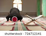 young imam praying inside of... | Shutterstock . vector #726712141