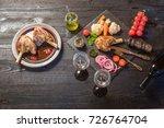 lamb shank dinner  with...   Shutterstock . vector #726764704