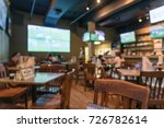Stock photo blurred people gathering and watching american football in a sport bar pub at famous bourbon street 726782614