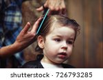 a little boy is trimmed in the... | Shutterstock . vector #726793285