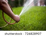 Man Watering Garden With Hose ...