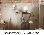 workman is plastering the wall...   Shutterstock . vector #726887755