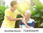 asian old man shoulder pain ... | Shutterstock . vector #726904699
