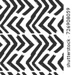 Hand drawn vector abstract rough geometric monochrome seamless zig zag chevron pattern in black and white colors.Hand made grunge brush painted texture.Scandinavian concept design for fashion,fabric | Shutterstock vector #726908059