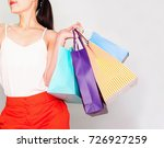 woman with a lot of shopping