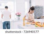 couple making salad healthy...   Shutterstock . vector #726940177
