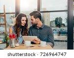 portrait of couple using... | Shutterstock . vector #726964747