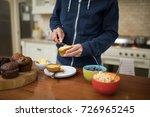 mid section of man preparing... | Shutterstock . vector #726965245