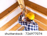 electrician working with wires...   Shutterstock . vector #726977074
