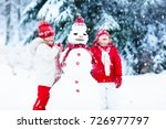 children build snowman. kids... | Shutterstock . vector #726977797