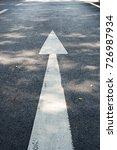 white arrow on the street. | Shutterstock . vector #726987934