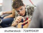 high school boy sttudent doing... | Shutterstock . vector #726993439