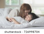 asian mother  kissing her son... | Shutterstock . vector #726998704