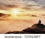 tourist sit on peak of...   Shutterstock . vector #727012897