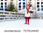 kids ice skating in winter park ... | Shutterstock . vector #727014445