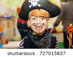 Halloween Party. A Little Boy...