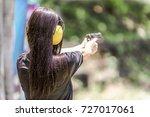 woman aiming pistol at target...   Shutterstock . vector #727017061