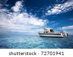 Sailing through tropical waters - stock photo