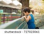 boy stand at green wooden chair ... | Shutterstock . vector #727023061