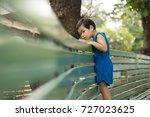 little boy stand at green... | Shutterstock . vector #727023625