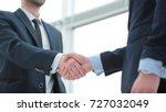 closeup. handshake business... | Shutterstock . vector #727032049
