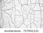 old cracked white paint.... | Shutterstock . vector #727041121
