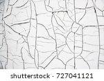 old cracked white paint.... | Shutterstock . vector #727041121
