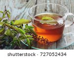 tulsi tea served in a cup with...   Shutterstock . vector #727052434