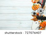 Stock photo halloween gingerbread cookies with candies on white wooden table 727076407