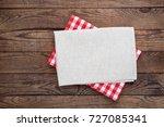 white napkin on wooden table.... | Shutterstock . vector #727085341