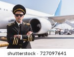 serious aviator locating near... | Shutterstock . vector #727097641