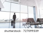 pilot locating near glass wall | Shutterstock . vector #727099339