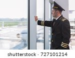 serious aviator looking at... | Shutterstock . vector #727101214