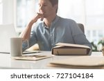 workplace of joyful pleasant guy | Shutterstock . vector #727104184