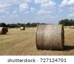Round Hay Bales In Field With...