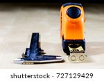 Small photo of Measure to measure distance. A measure lying on a wooden table. Black background