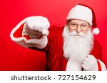 father christmas beats fists ... | Shutterstock . vector #727154629