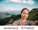 young woman hiker smiling and... | Shutterstock . vector #727160635