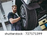 handsome mechanic in uniform is ... | Shutterstock . vector #727171399