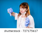 female doctor shows thumb down... | Shutterstock . vector #727175617