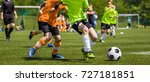 young boys playing soccer... | Shutterstock . vector #727181851