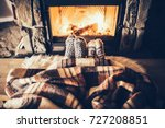 feet in woollen socks by the... | Shutterstock . vector #727208851